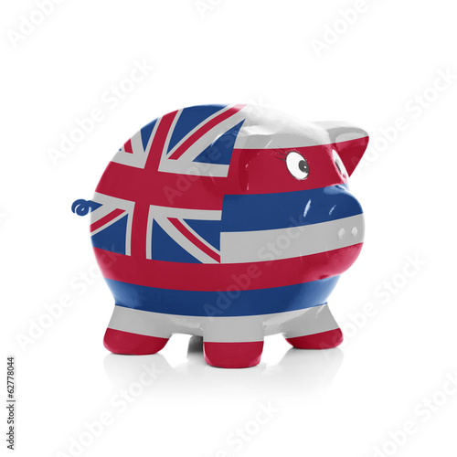Piggy bank with flag coating over it - State of Hawaii