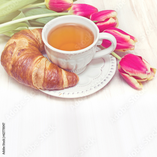 Vintage style breakfast tea and flowers