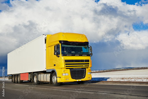 canvas print picture lorry with trailer driving on highway
