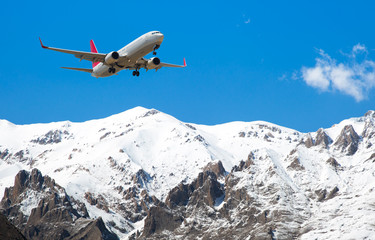 Airplane over the mountains