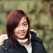 junge asiatische frau im park