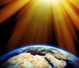 Warm sun beams on earth