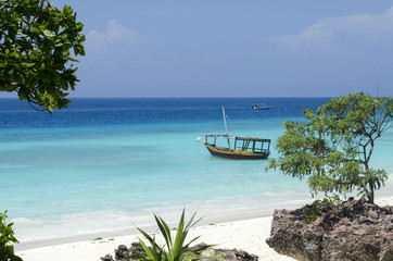 Beach and boat on turquoise water in Zanzibar, Tanzania, Africa