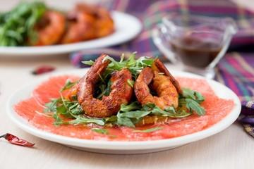Carpaccio of grapefruit with rucola, arugula salad and spicy