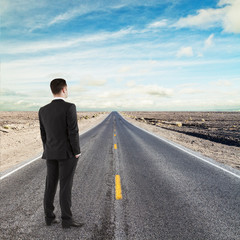 businessman standing on road