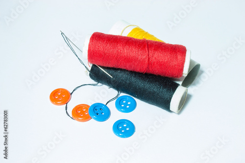 Sewing supplies on white back ground