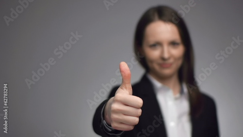 young businesswoman giving the thumbs up