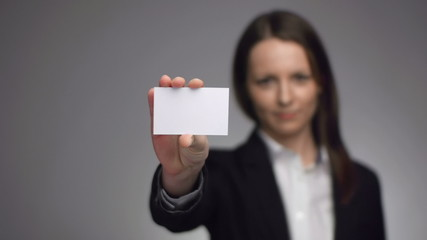 nice looking businesswoman showing a business card