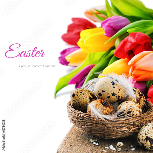 Easter setting with quail eggs and tulips