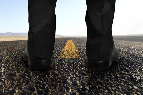 feet standing on road