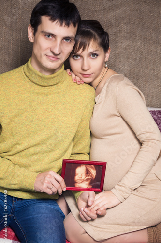 Portrait of happy regnant couple