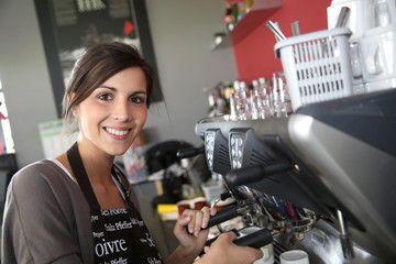 Waitress preparing coffee from machine