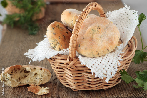 Flat bread with greens in basket and slice