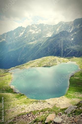 Lake in Italian Alps, Stelvio National Park. Cross processed.