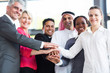 multiracial business team hands together