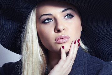 Beautiful Blond Woman in Black Hat. Fashionable Lady