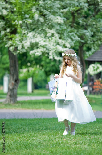 First Communion - girl looks at her gifts