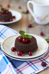 Chocolate fondant lava cake with cranberry and mint