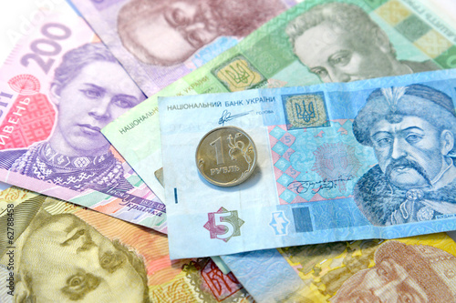 One Russian ruble against the Ukrainian paper money