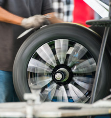 Inside a garage - changing wheels-tires during spining