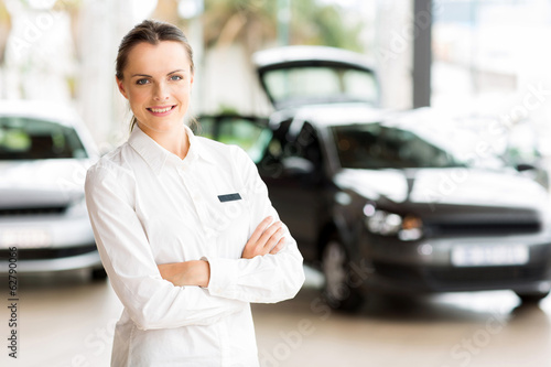 young sales consultant in car showroom