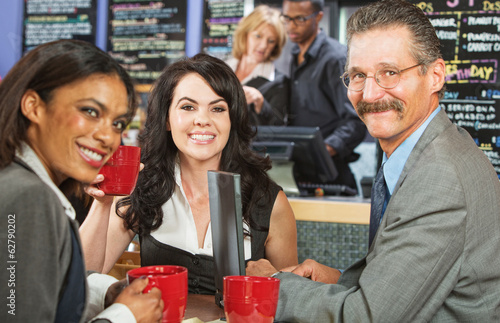 Three Happy Executives Drinking Coffee