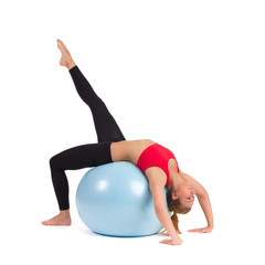 Young Female Stretching on Exercise Ball