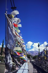 prayer flags on the bridge in Leh