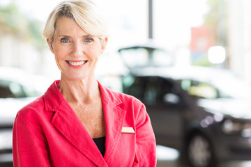 senior woman working at car dealership
