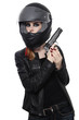 Woman in biker helmet with gun