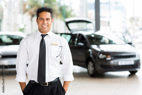 indian man working at vehicle showroom