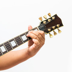 The guitarist show the E Major chord