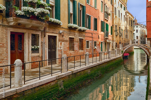 Canal bridge and buildings in Venice.
