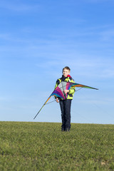 Boy prepares for start of a kite