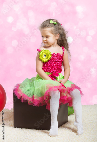 Portrait of a cute little girl looking away, abstract background