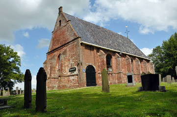 A small old protestant church gothic style  in Dutch Friesland