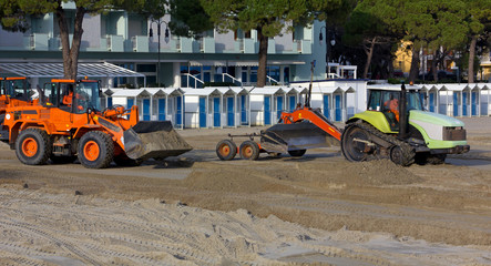Bulldozers at Work on a Sandy Beach