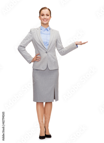 businesswoman showing something on her hand