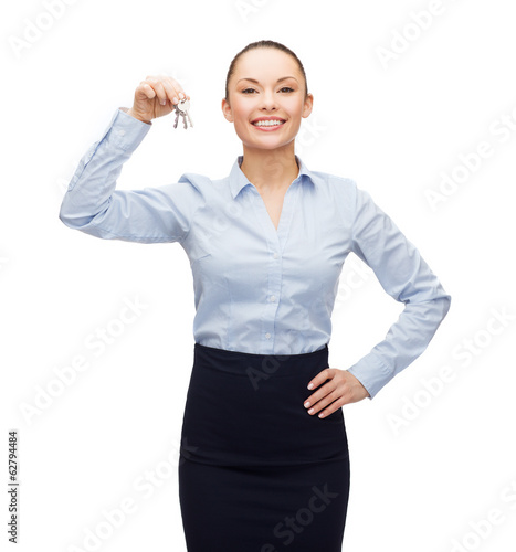 smiling businesswoman with house keys