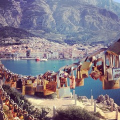 Love padlocks with city of Makarska at background