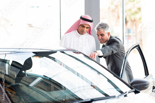 senior dealer pointing car features