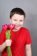 Boy with a bouquet of red tulips