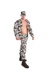 Sexy naked military man posing on a white background