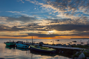 Peaceful sunset dramatic sky and boats