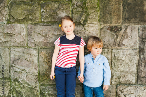 Outdoor portrait of two adorable children