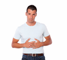 Young hispanic male with stomach pain