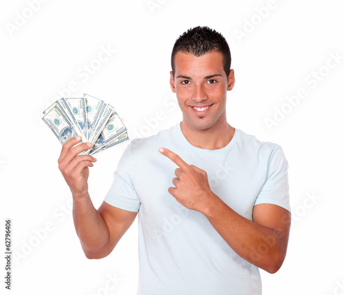 Handsome latin man pointing at his money