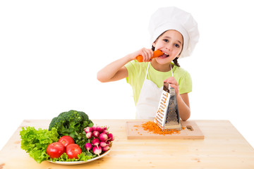 Girl with grater eating the carrots