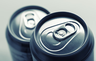 Aluminum cans closeup picture isolated on gray