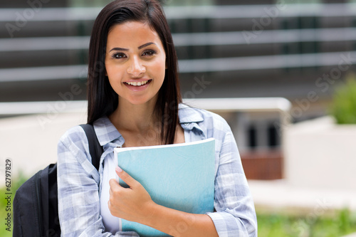 college girl holding a book